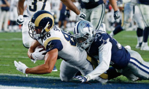 Los Angeles Rams wide receiver, left, scores a touchdown as he is tackled by Dallas Cowboys defensive back in the preseason NFL football game, Saturday, Aug. 13, 2016. (AP Photo/Ryan Kang)